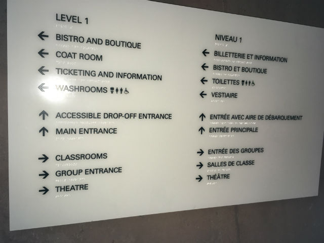 interior sign with braille and directions